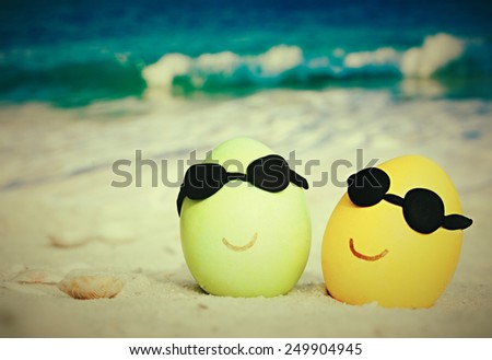 Two easter eggs with sunglasses on ocean beach �retro style  - stock photo