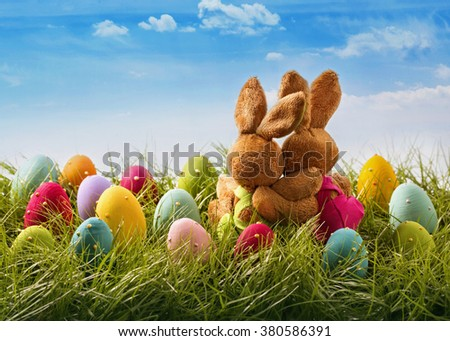 Two easter rabbits sitting on grass