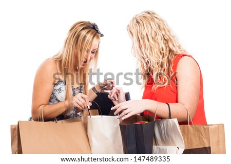 Two ecstatic blond girls with shopping bags, isolated on white background - stock photo