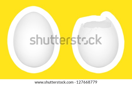 Two eggs isolated on white with yellow background, one cracked and one intact - stock photo