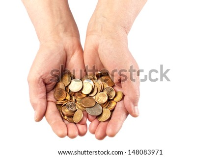 Two elderly hands holding a pile of coins. Viewed from top and isolated on white with copy space. - stock photo