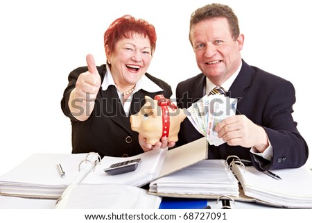 Two elderly people holding European money and a piggy bank - stock photo