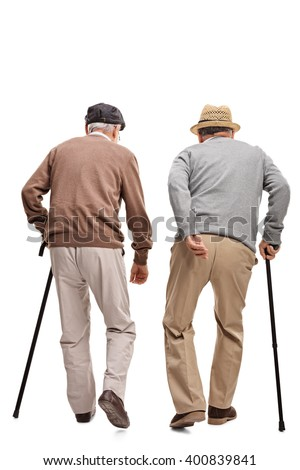 Two elderly people walking with canes isolated on white background, rear view  - stock photo