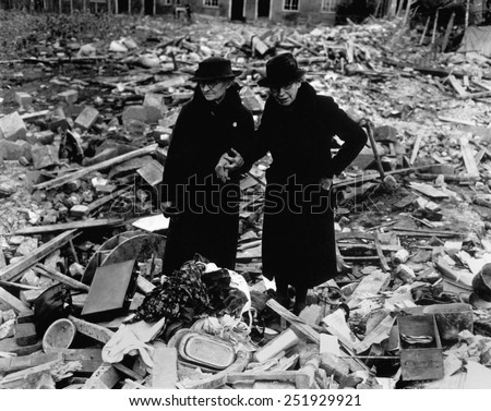 Two elderly women stand amid the ruins of the Almshouse that had been their home. The Germans bomber Newbury, Berkshire, England on Feb. 10, 1943. World War 2. 10_59) - stock photo