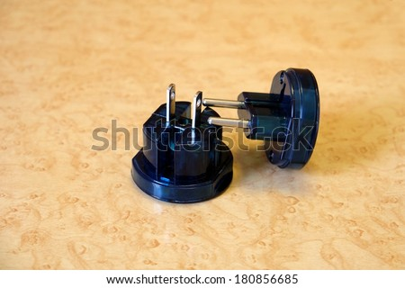 two electric adapter on the table - stock photo