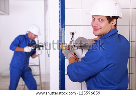 two electricians' work - stock photo