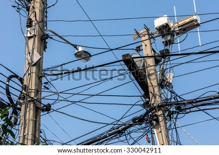 Two electricity posts / Messy wire  cable