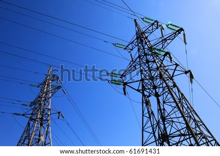 Two electricity pylons - stock photo