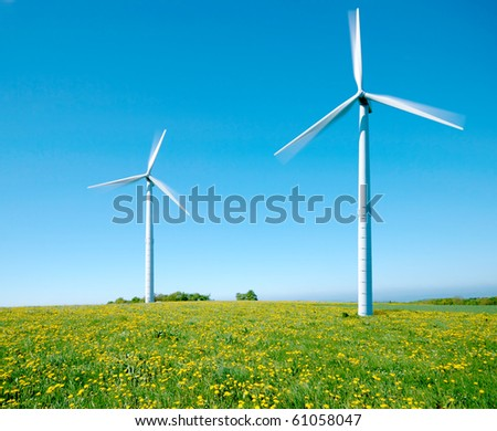 Two electricity windmills under the clear blue sky