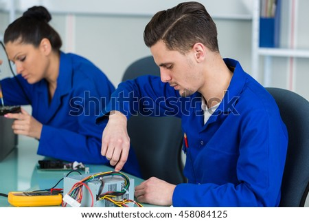 two electronic students in class