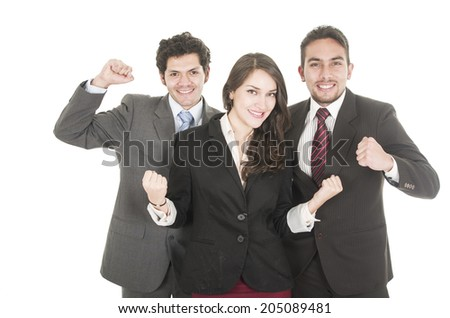 two elegant businessmen and a businesswoman in suits posing with fists up