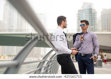 Two elegant businessmen talking about business. - stock photo
