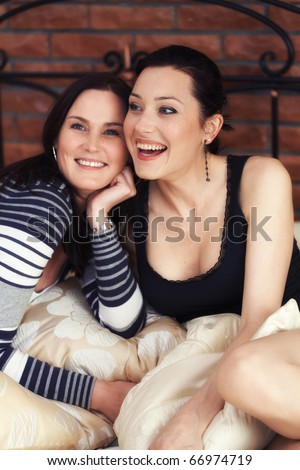 Two elegant sexy sisters looking at camera - stock photo
