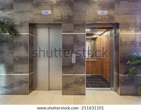 Two elevators in hotel lobby - stock photo