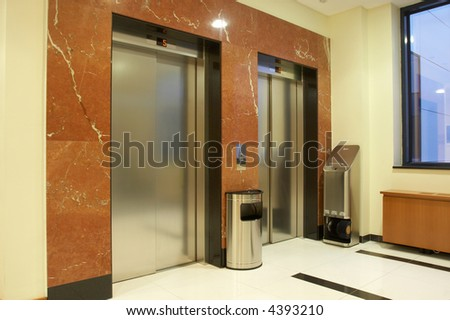 Two elevators in luxurious interior
