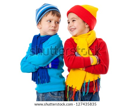 Two emotional kids in winter clothes showing a different emotions, isolated on white - stock photo