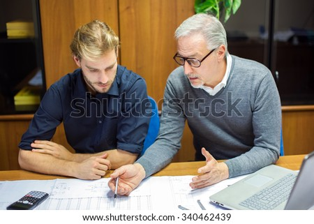 Two employees at work in an office - stock photo
