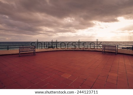 Two empty benches tranquil retro scene with empty copy space. - stock photo