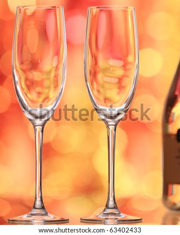 Two empty champagne glass against Christmas background