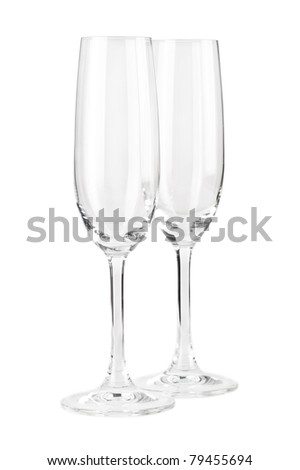 Two empty champagne glasses isolated on white - stock photo