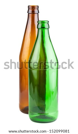 Two empty green and brown beer bottles isolated on white background - stock photo