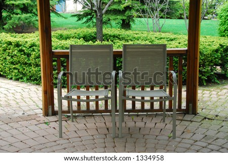 Two empty patio chairs