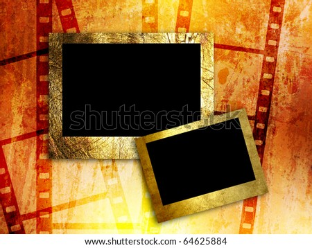 two empty photo frames on film strip background - stock photo