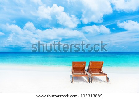 Two empty sunbed on the beach, beautiful seascape, relaxation on Maldives island, luxury summer vacation concept - stock photo
