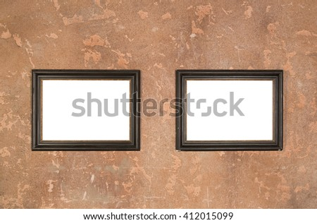 Two empty vintage brown frame on wall background - stock photo