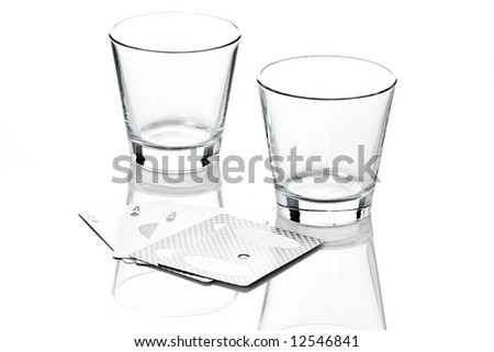 Two empty whiskey glasses with cards isolated on white background - stock photo