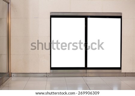 two empty white blank billboards on the wall in metro - stock photo