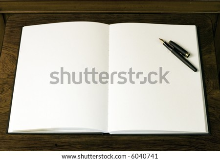 Two empty white pages and pen in book or notepad - stock photo