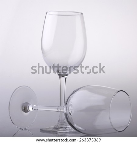 Two empty wineglasses on light background - stock photo