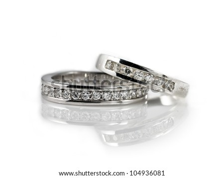 Two engagement rings on white background - stock photo