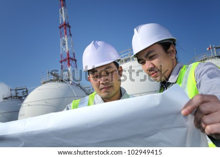 two engineer discussion about plan working on location site - stock photo