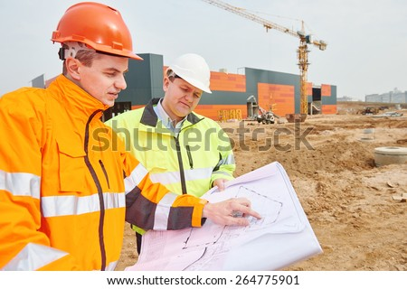 two engineers construction foreman managers at building site with blueprints - stock photo