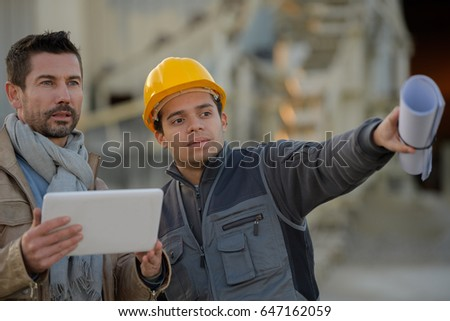 two engineers going through routine checks