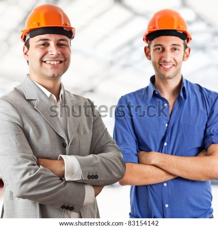 Two engineers portrait - stock photo