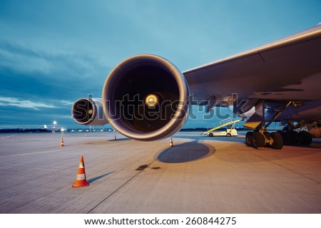 Two engines of the large airplane at the airport. - stock photo