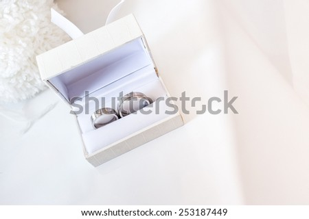 Two engraving wedding rings in white box - stock photo
