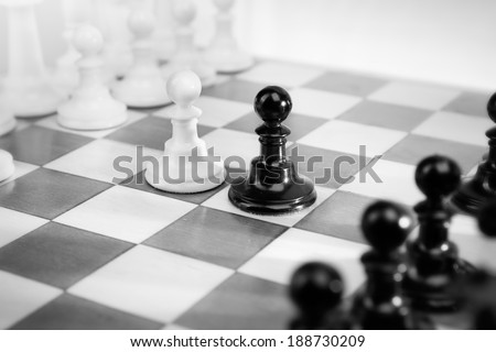 Two equally powerful adversaries facing each other - stock photo