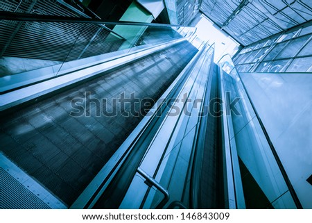 two escalators in a mall or in an airport - stock photo