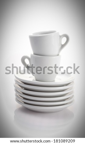 two espresso cups and saucers isolated on a white background