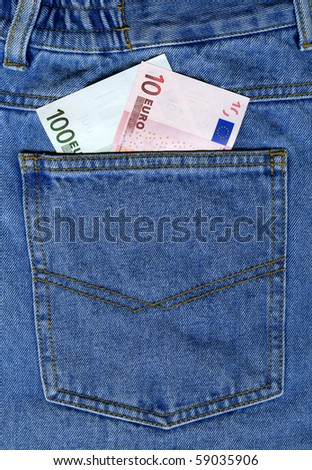 Two euro banknotes in blue jeans back pocket
