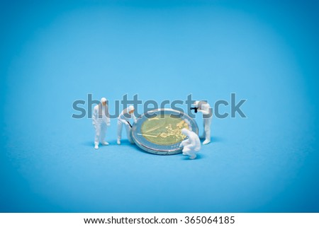 Two euro coins being inspected by specialist.  - stock photo