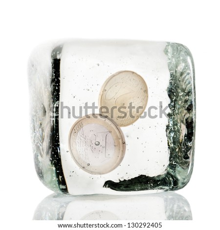 Two euro coins frozen in ice cube - stock photo