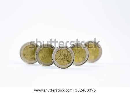 Two euro coins in a row isolated on a white background  - stock photo