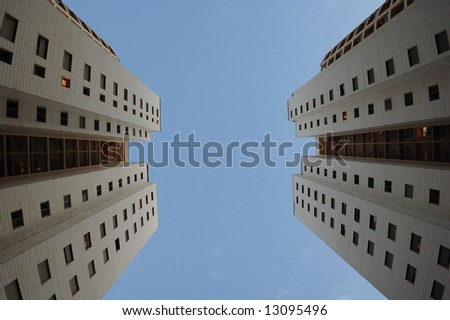 Two evening buildings, twilight and perspective in the sky - stock photo