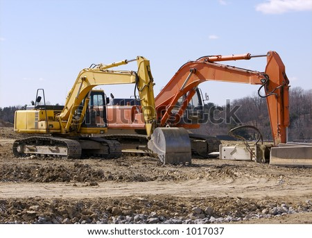 Two Excavators at Construction Site