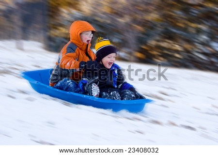 Two Excited Boys Snow Sled - stock photo